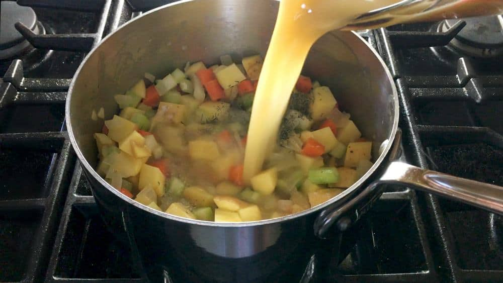Adding Stock to Vegetables and Seasonings