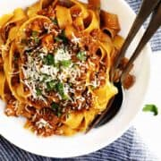 ragu sauce with pasta served in a white bowl
