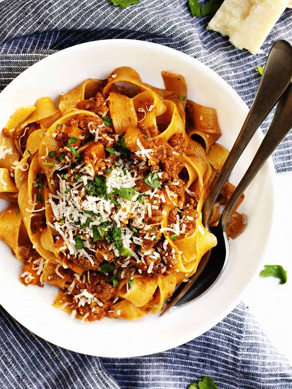 ragu sauce with pasta in a white bowl