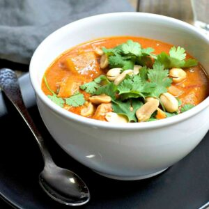 West African Chicken and Peanut Stew (also called African Chicken Peanut Soup) is spicy, rich and deeply flavorful. A mixture of tender sweet potatoes and buttery chicken simmered in a comforting mixture of broth, coconut milk, peanut butter, garlic, ginger, coriander and cayenne. It's a deeply comforting meal.
