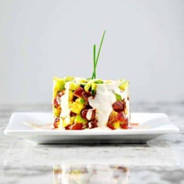 Tuna-Tartare-with-Avocado served on a white plate
