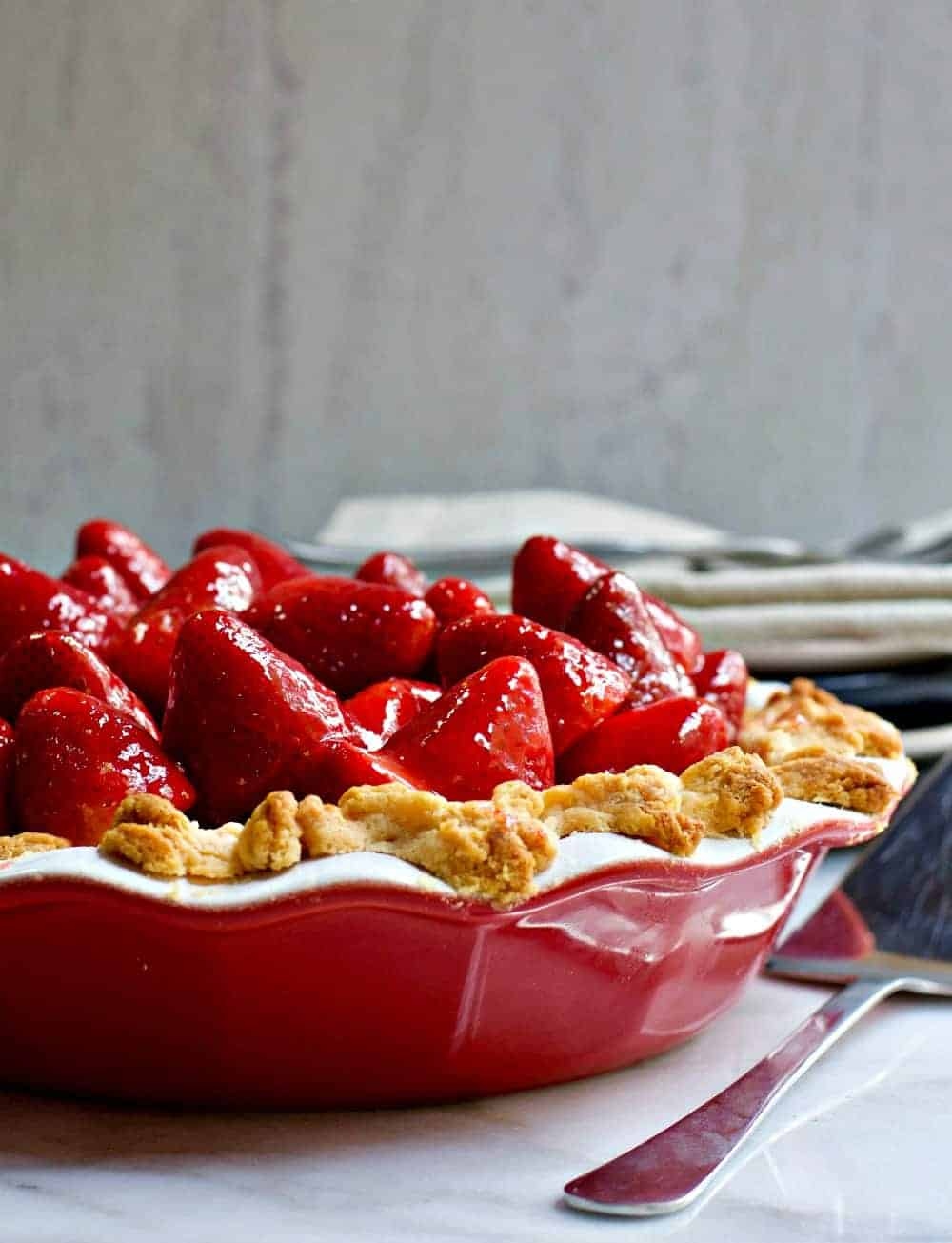 Fresh Strawberry Pie served in a red ceramic pie pan