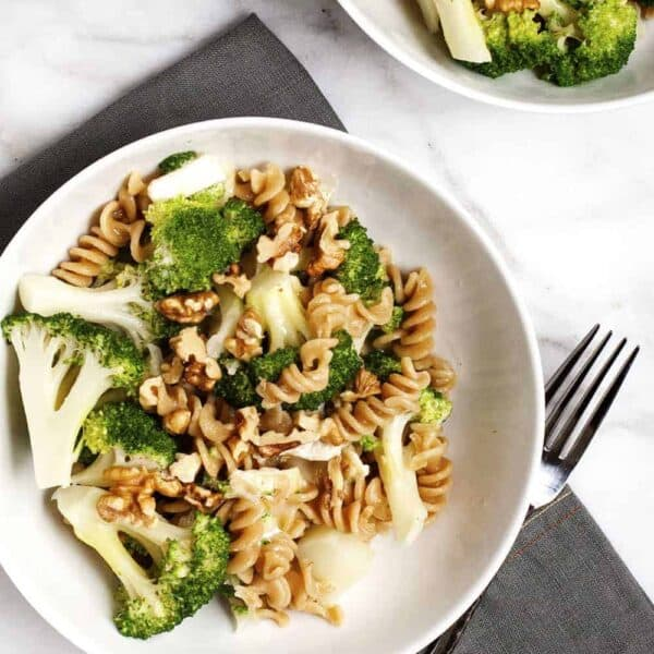 Broccoli-Pasta with Brie and Walnuts in white bowls featured
