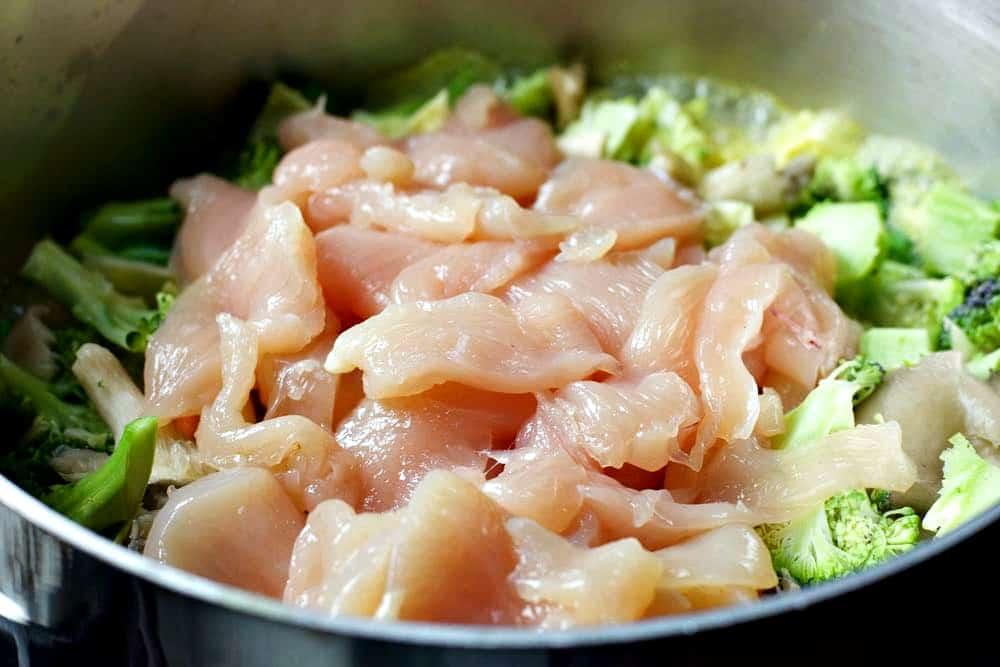 Raw Chicken on Tom Kha Gai ready to steam