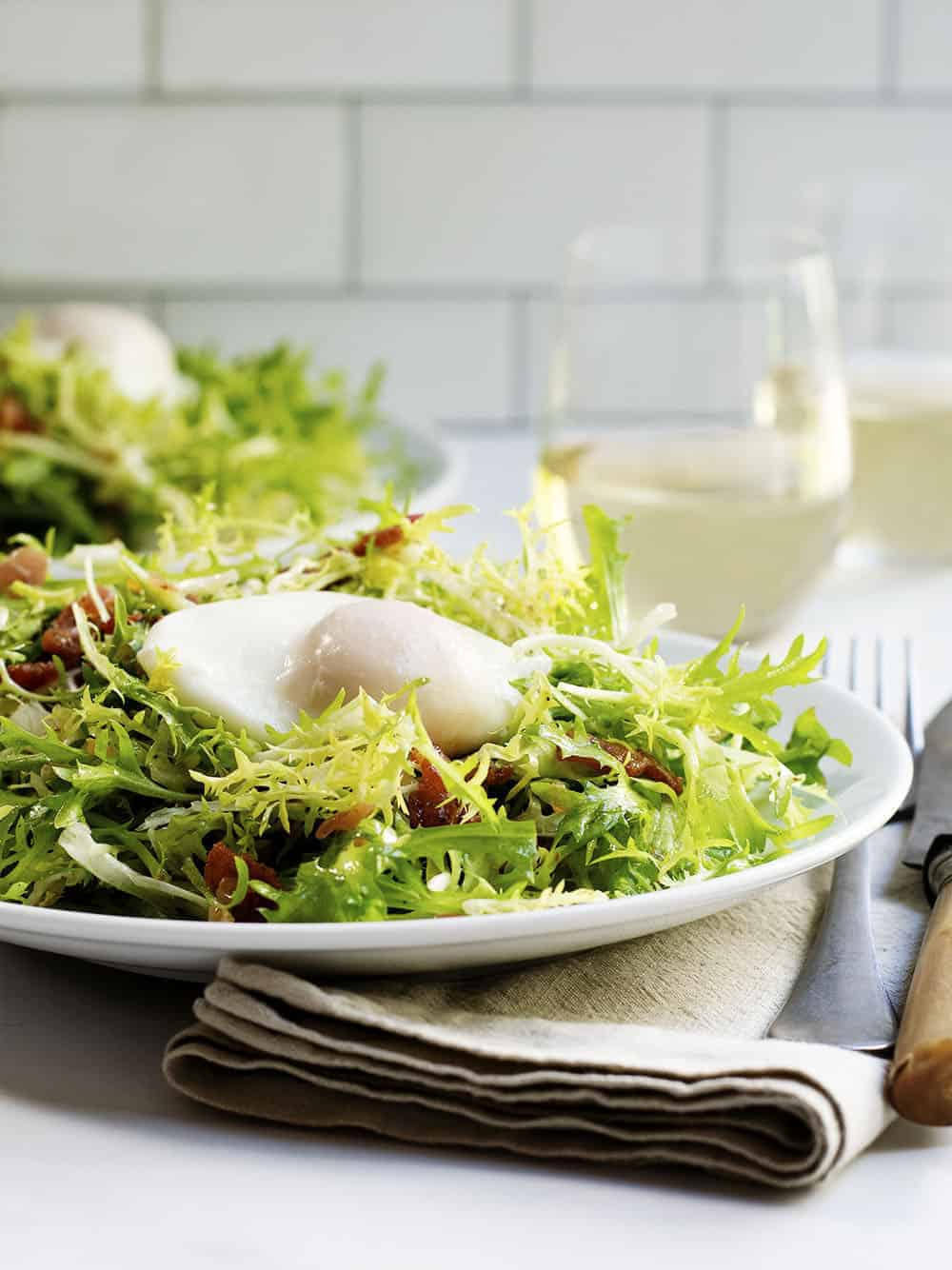 Salad Lyonnaise served on a white plate