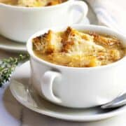 French Onion Soup served in white bowls