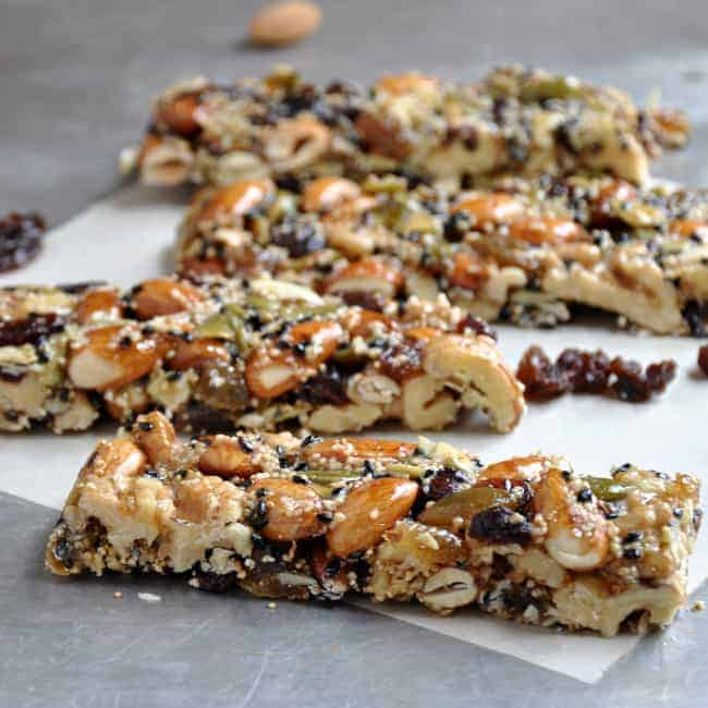 homemade fruit and nut bars on a baking sheet