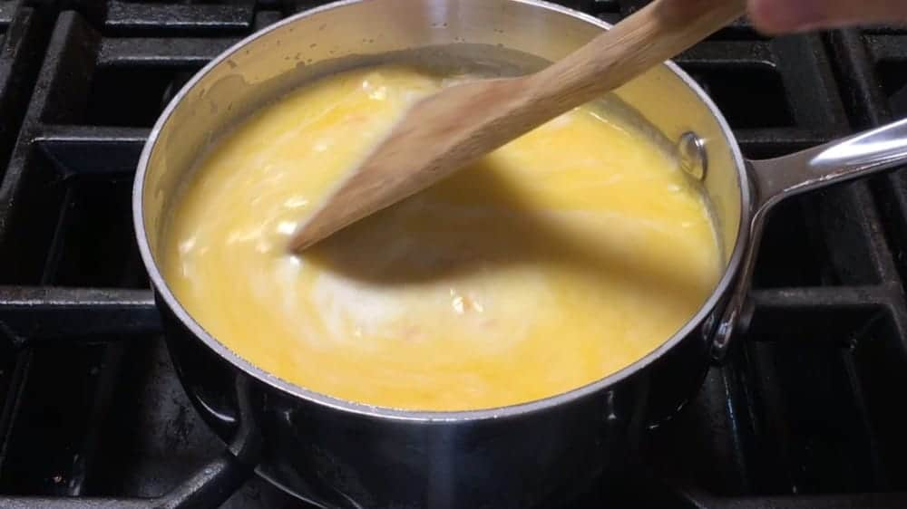 Melting butter with milk and fresh corn kernels