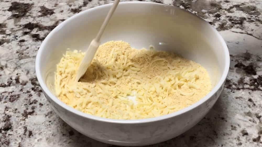 Stirring cheese into dry ingreidents for corn cakes