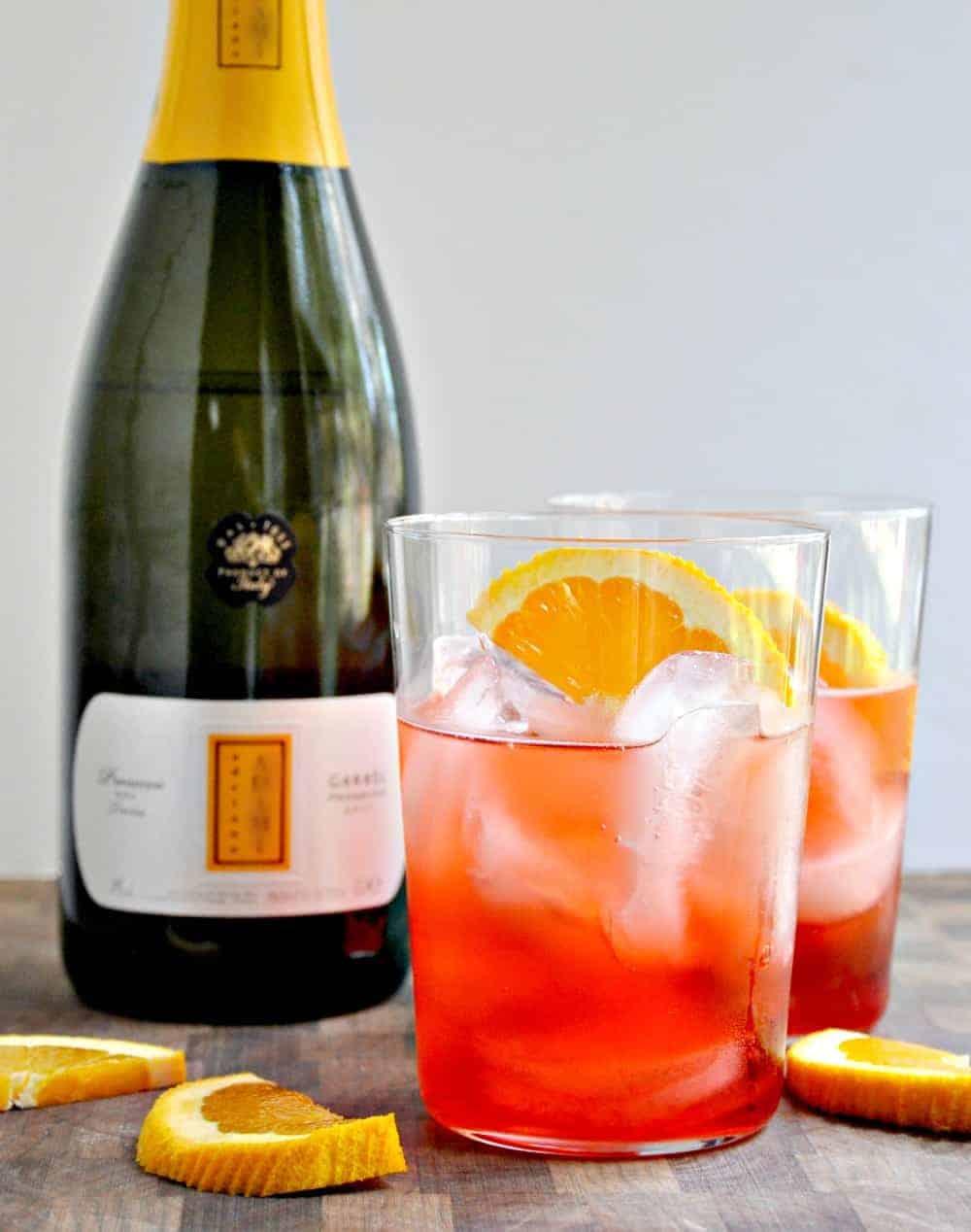 Campari Spritz served in clear glasses with orange slices