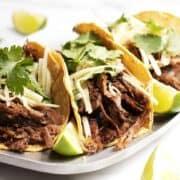 Pork Carnitas Tacos served on a metal platter