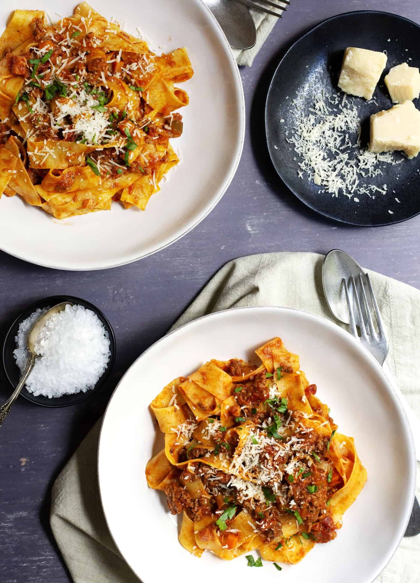 Bolognese Sauce served with pappardelle in shallow white bowls