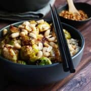 Kung Pao Brussels Sprouts served in a black bowl
