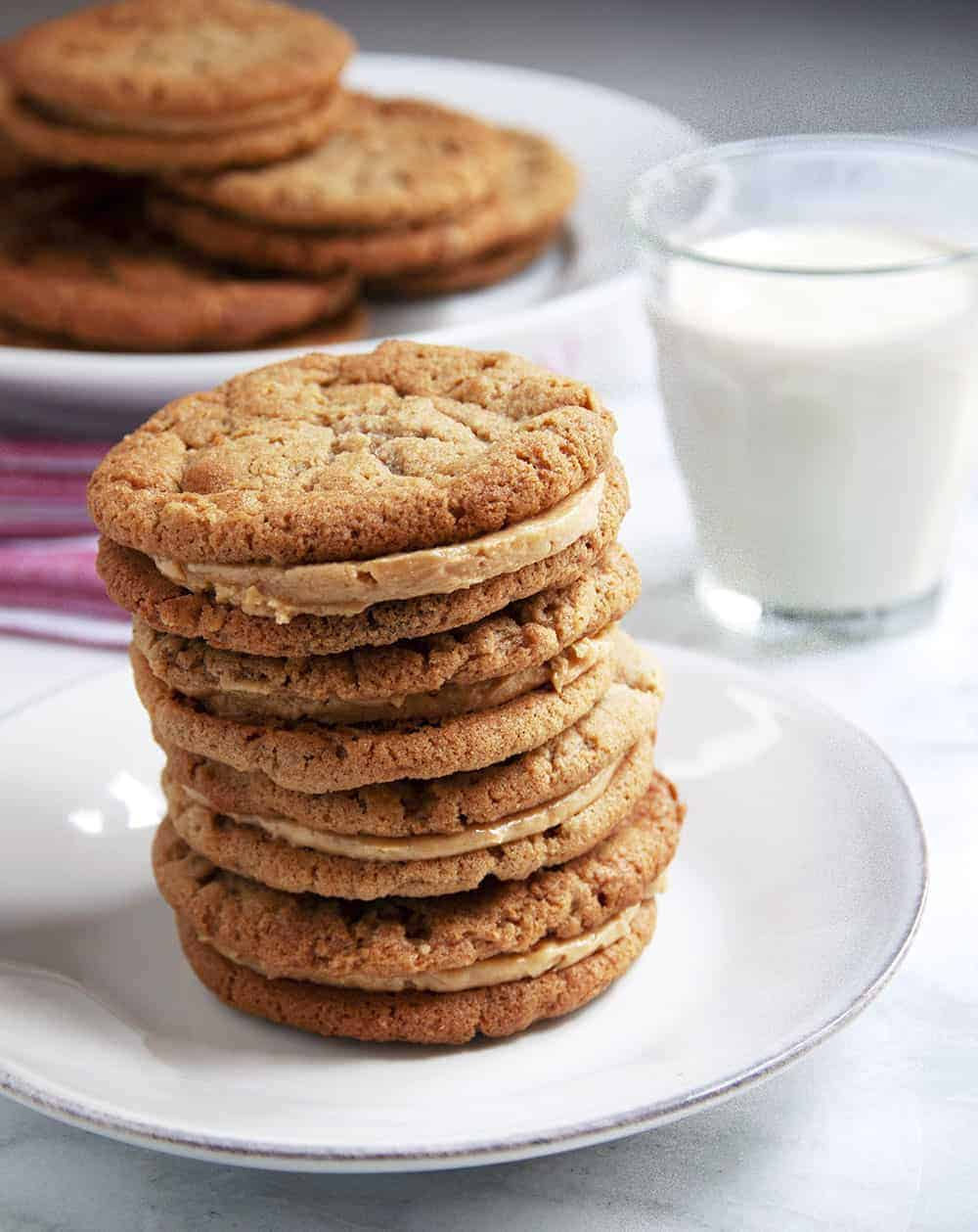 Peanut Butter Sandwich Cookie Stack with glass of milk