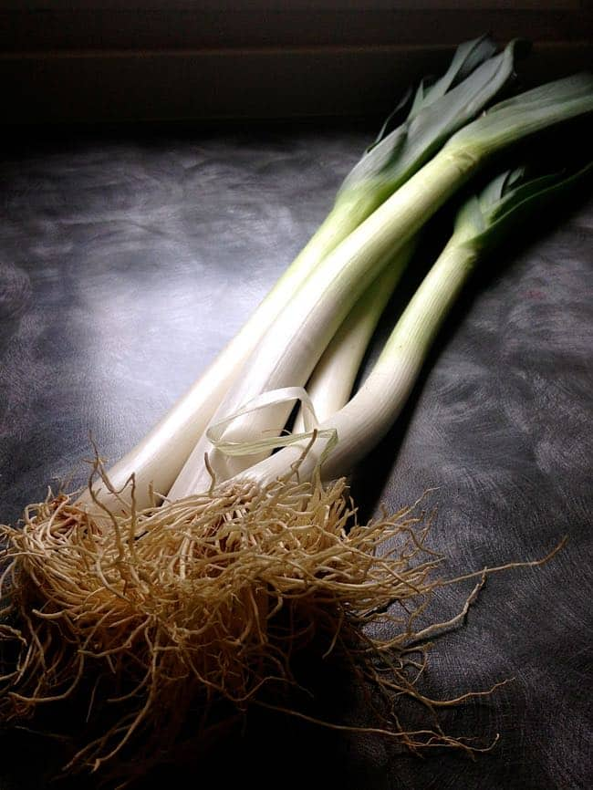 leeks on a black counter