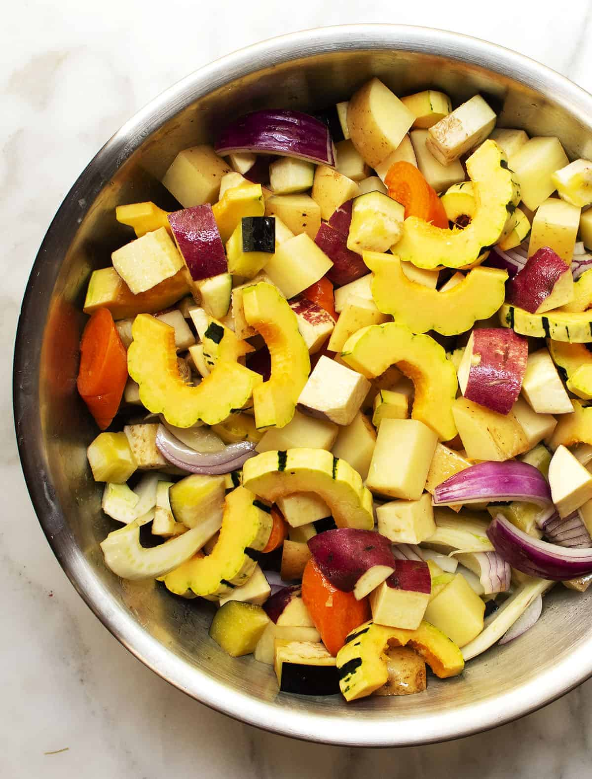 fall vegetables cut up in stainless steel bowl