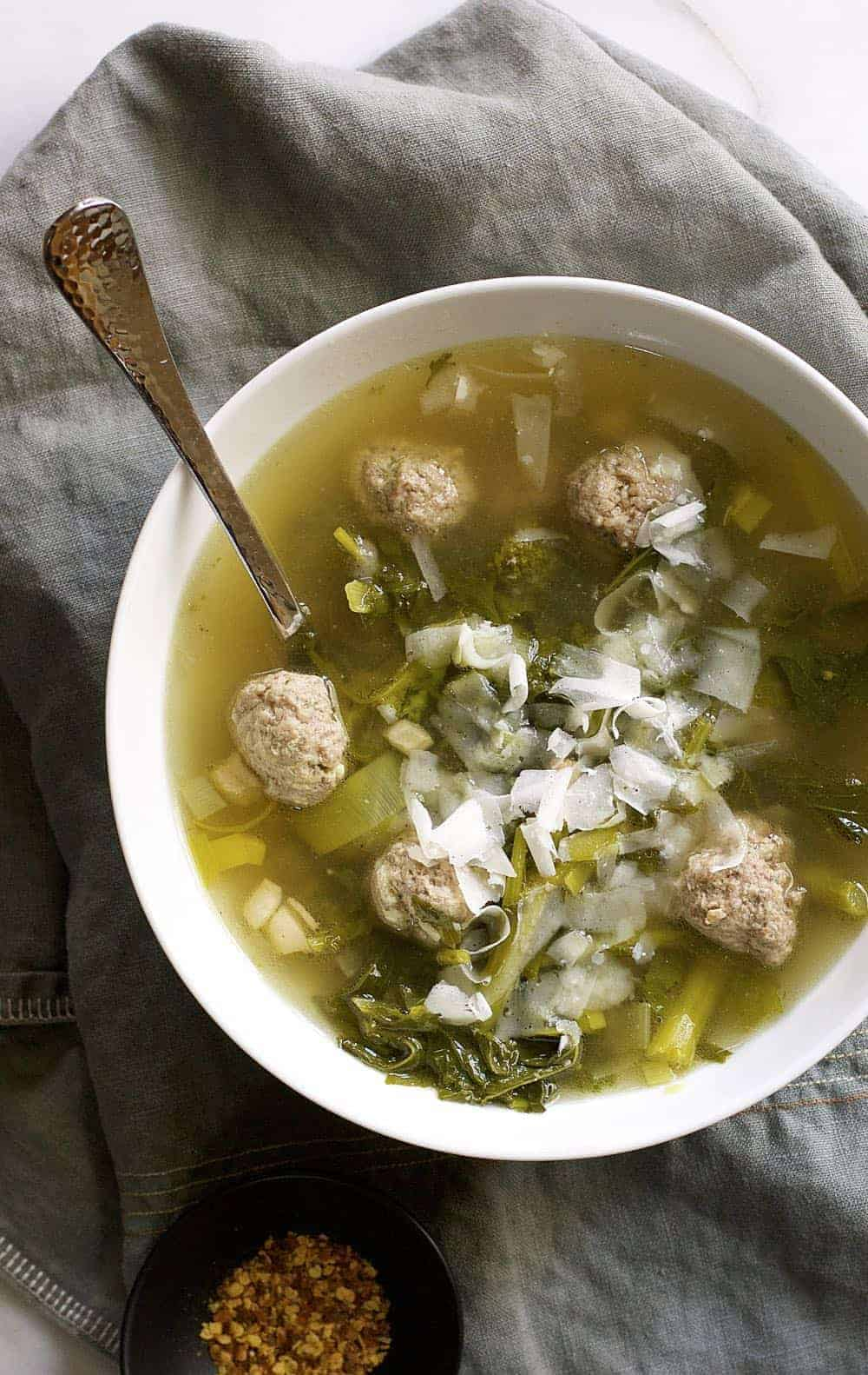 Why I love this easy Italian Wedding Soup recipe: it has a delicate and flavorful broth, but is entirely hearty because it's loaded with meatballs! It's a crowd-pleasing meal that you can whip up in about half an hour.