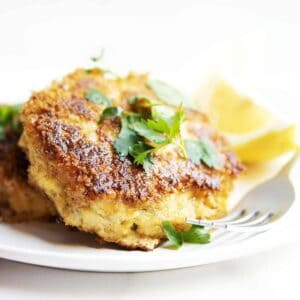 cod fish cakes served on a white plate