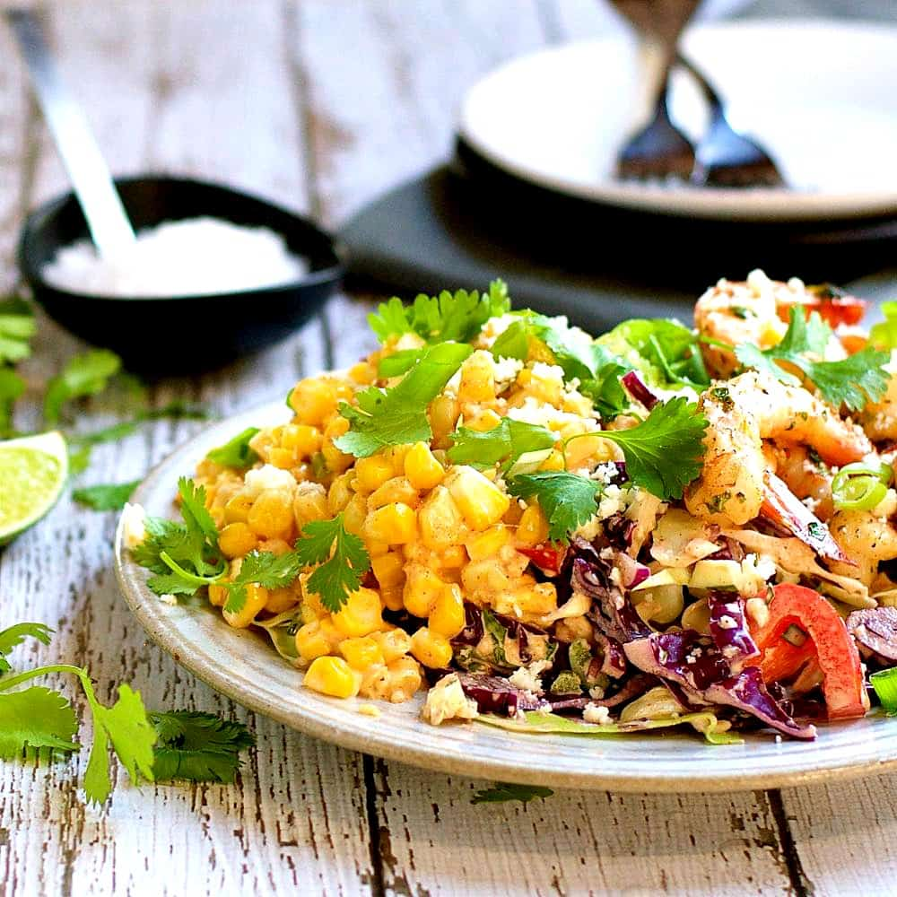 Mexican Street Corn Salad serve on a white plate