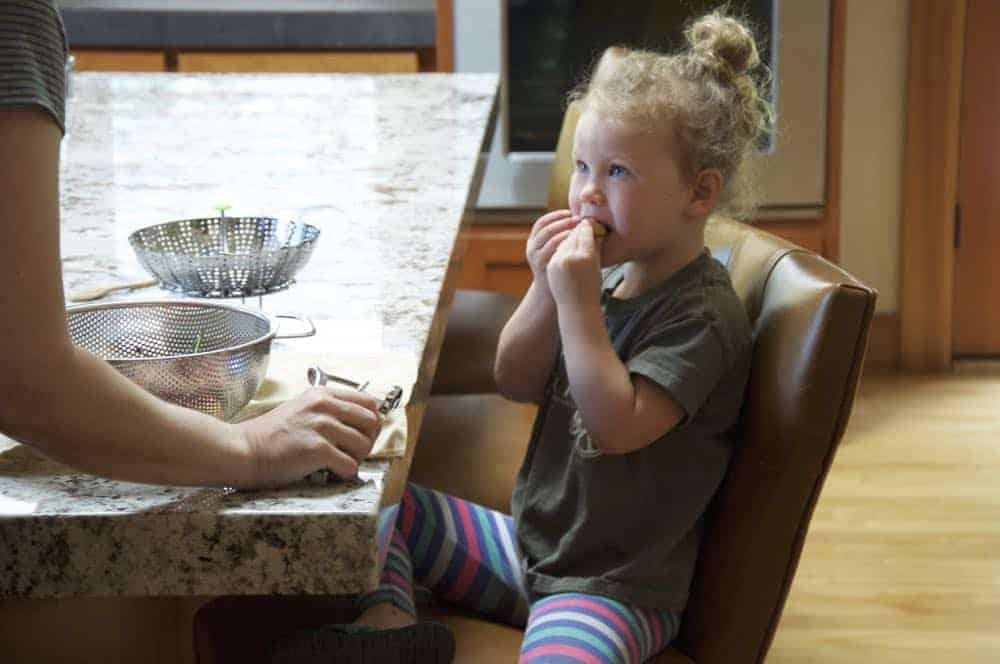 Hannah eating a cherry