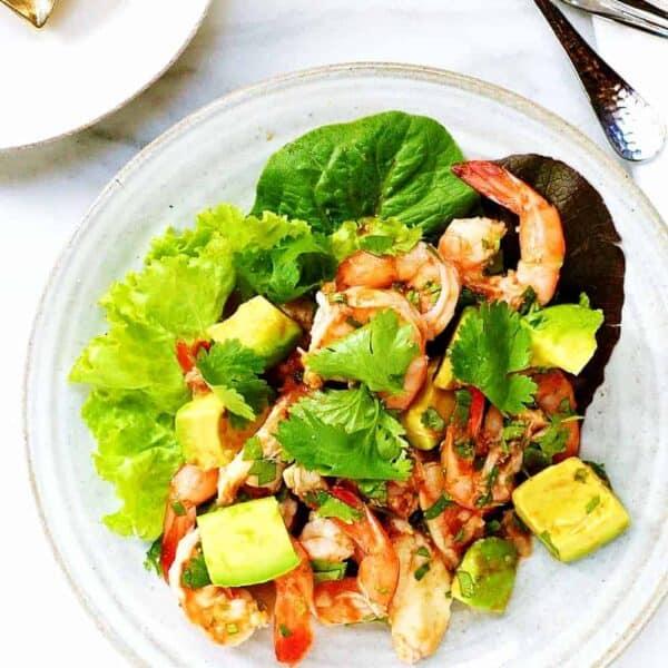 Shrimp-Crab-Avocado-Salad served on a ceramic plate featured