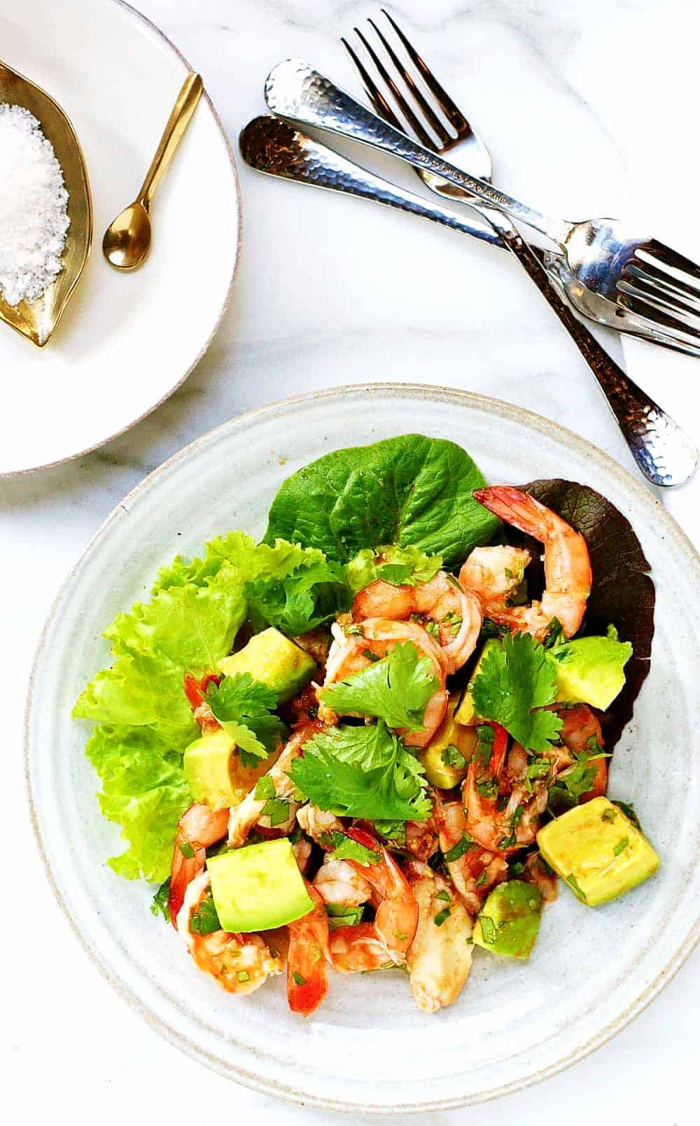Shrimp-Crab-Avocado-Salad served on a ceramic plate