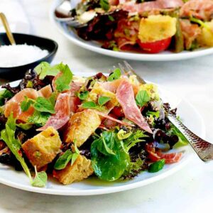 Muffuletta Panzanella Bread Salad served on white plates featured