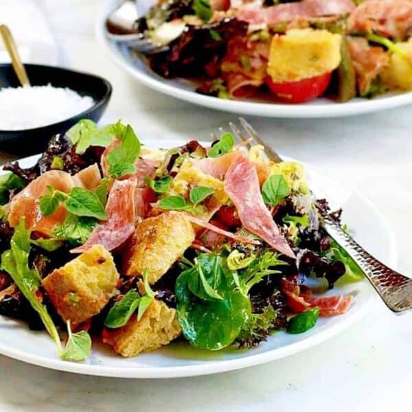 Muffuletta Panzanella Bread Salad served on white plates featured