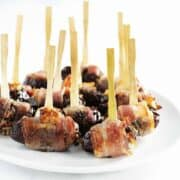 Bacon Wrapped Dates served on a white platter