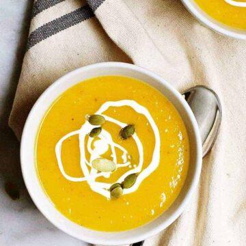 Vegan Butternut Squash Soup served in white bowls