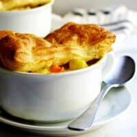 Chicken-Pot-Pie-with-Puff-Pastry served in white bowls featured