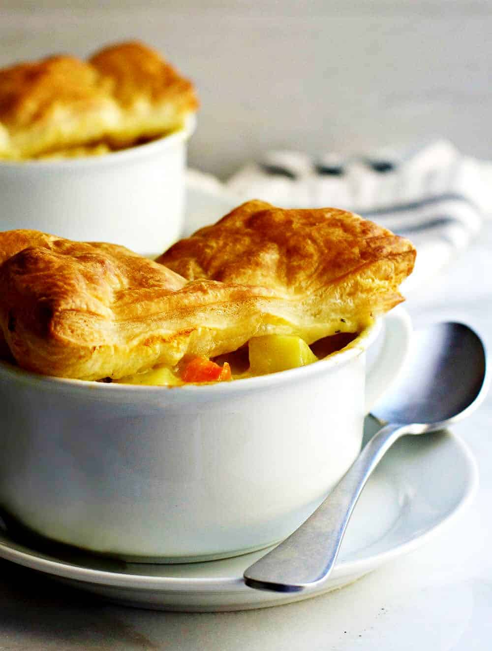Chicken-Pot-Pie-with-Puff-Pastry served in white bowls