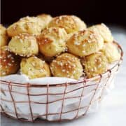 chouquettes served in a cloth lined copper basket