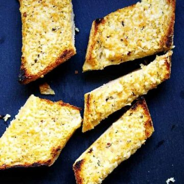 Easy-Cheesy-Garlic-Bread served on a gray board