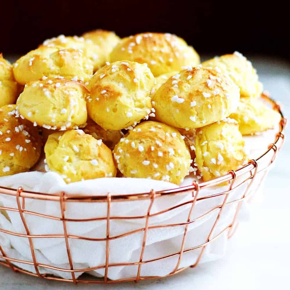 Homemade-Chouquettes-French-Pastry-Sugar-Puffs served in a wire basked featured