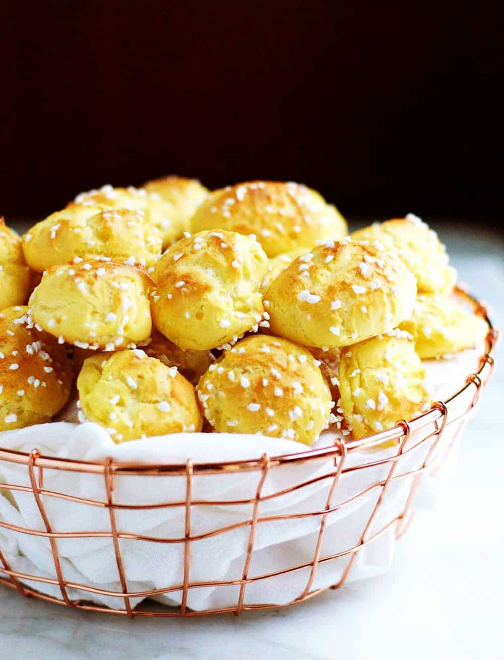 Homemade-Chouquettes-French-Pastry-Sugar-Puffs served in a wire basked