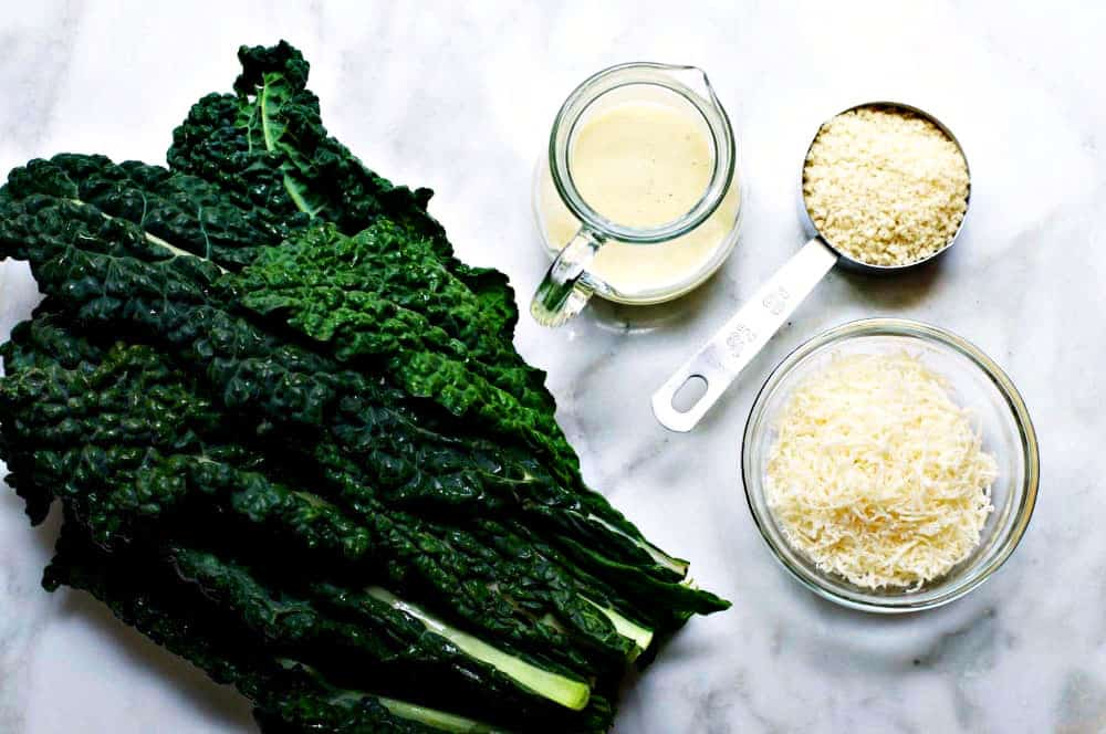 Kale-Caesar-Salad-Ingredients on a marble board
