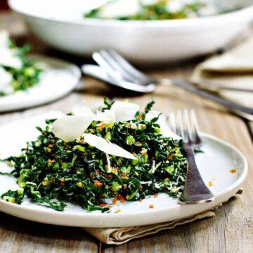 Kale Caesar Salad served on white plates
