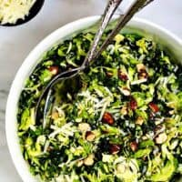Kale-and-Brussel-Sprout-Salad served in a white bowl