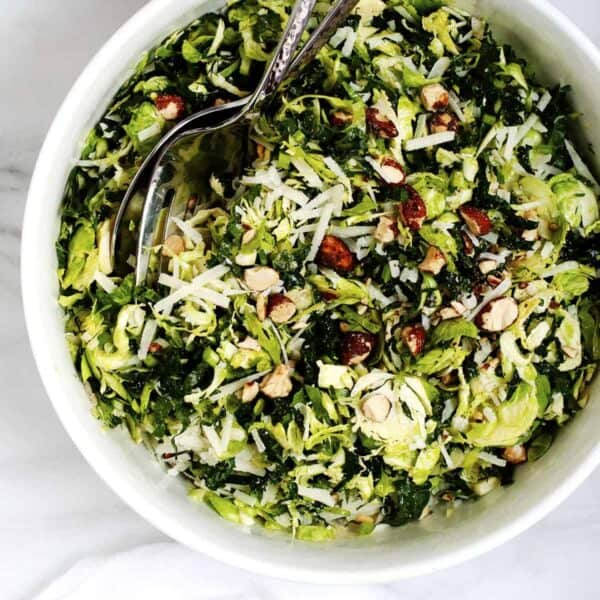 Kale and Brussels Sprouts Salad served in a white bowl