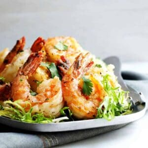Salt-and-Pepper-Shrimp-served-on-a-stainless-steel platter featured