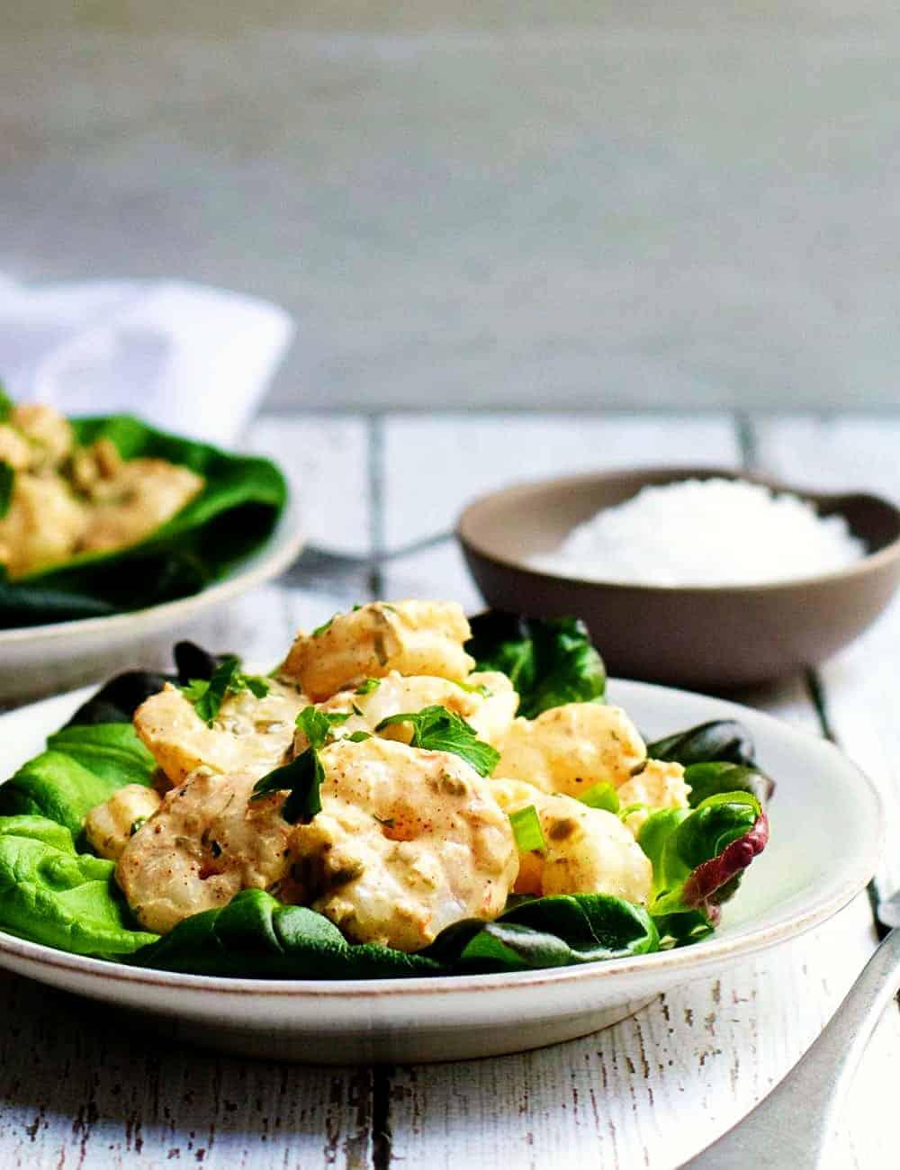 Shrimp-Remoulade-Salad_ served on white plates