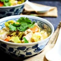 Tom-Kha-Gai-Thai-Coconut-Chicken-Soup served in blue and white bowls featured