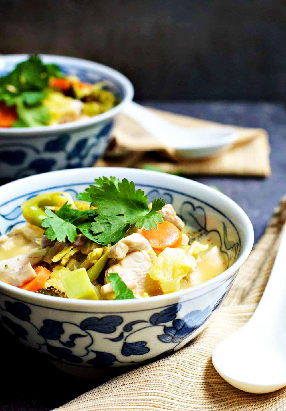 Tom Kha Gai Thai Coconut Chicken Soup served in blue and white bowls