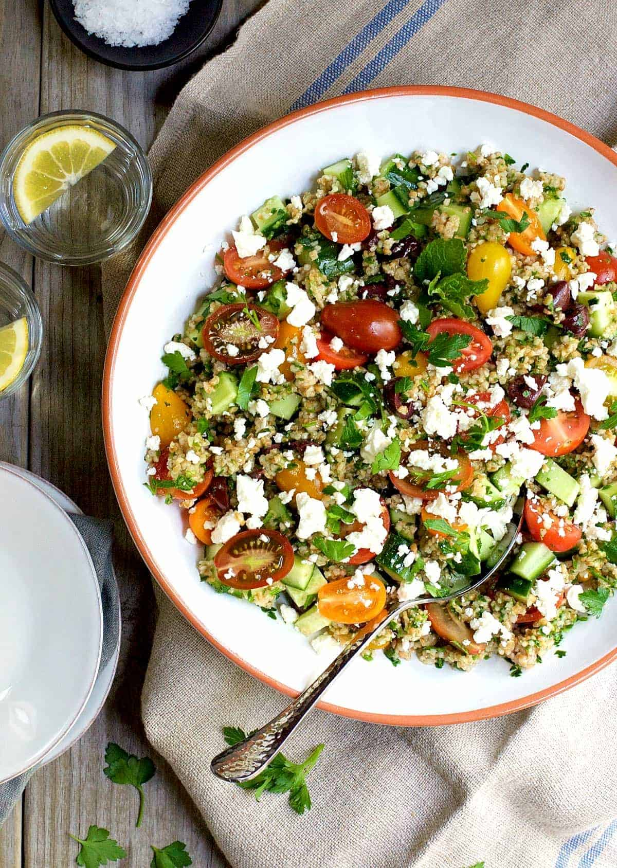 Tabouli salad is a classic Levantine dish (also spelled tabbouleh and tabouleh), a vegetarian salad that is loaded with flavor and texture. From crisp cucumber, sweet tomatoes, briny olives and bright parsley, every bite is a little different. Bulgur wheat makes the salad hearty enough to make it a main dish and I love to add salty creamy feta to make the salad even better.