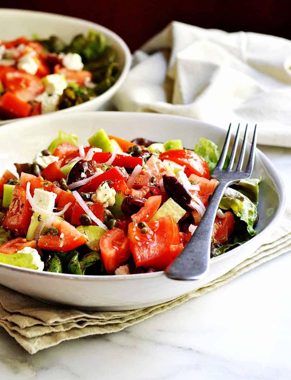 Greek-Salad served in white bowls