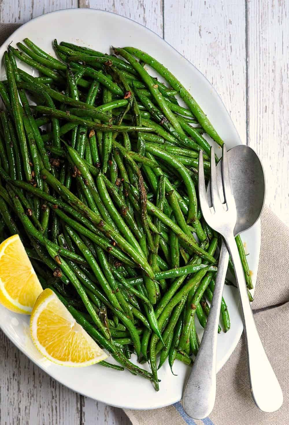 Grilled Green Beans with Lemon Wedges