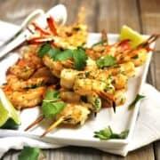 Grilled Shrimp skewers served on a white platter square