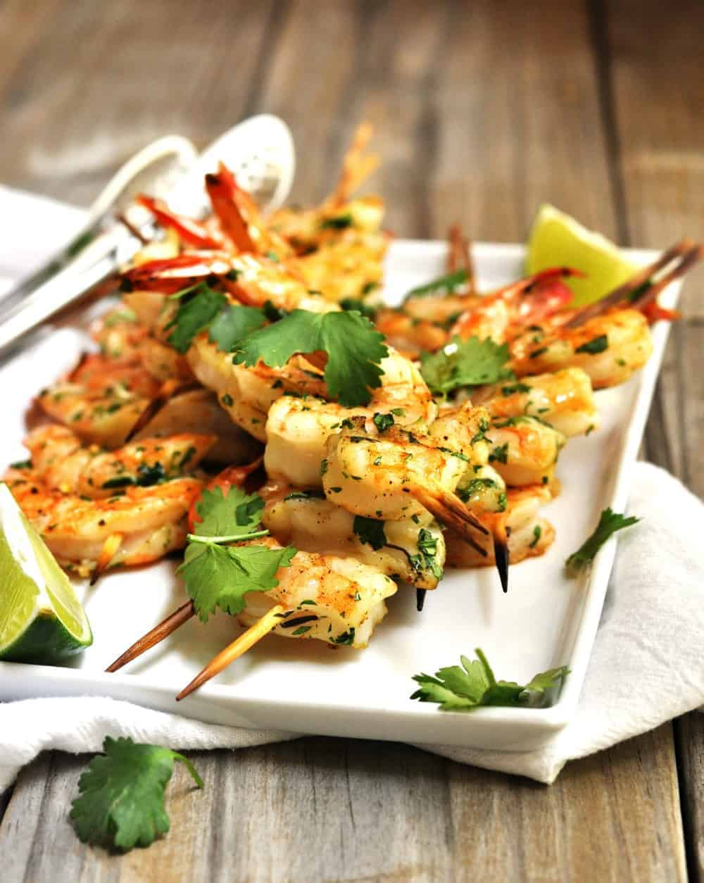 Grilled Shrimp skewers served on a white platter