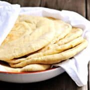 Pita-Bread served in a bowl wrapped in white cloth featured